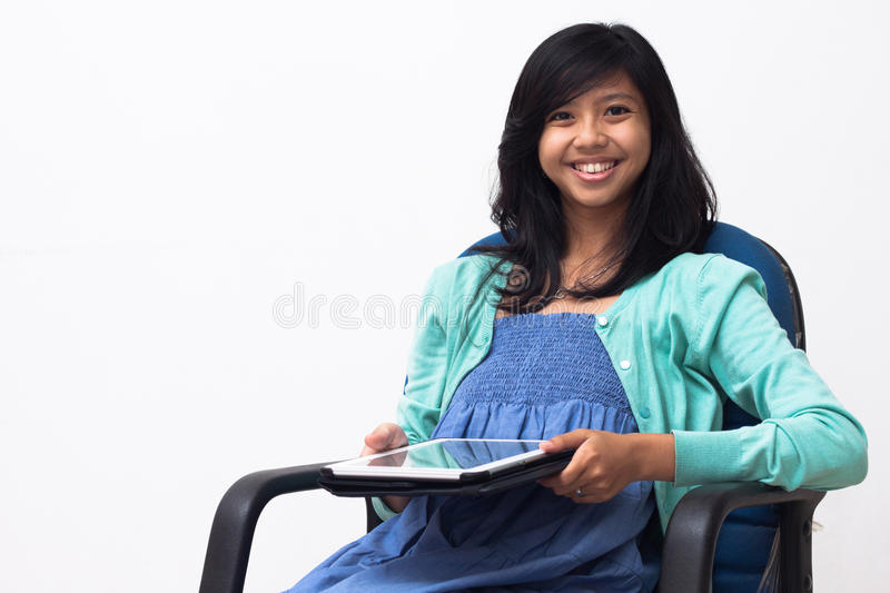 Isolated Smiling Young Business Woman Holding Her Tablet Pc Royalty Free Stock Image