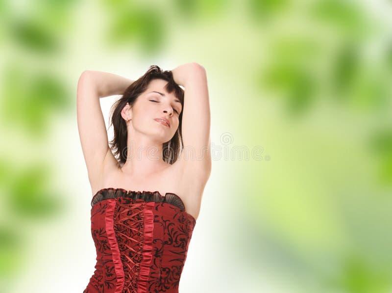 Enjoyment. Beautiful young girl enjoying spring royalty free stock image