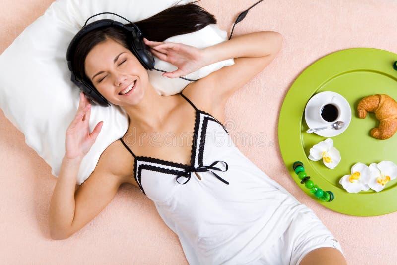 Download Enjoyment stock photo. Image of brunette, listening, female - 8613116