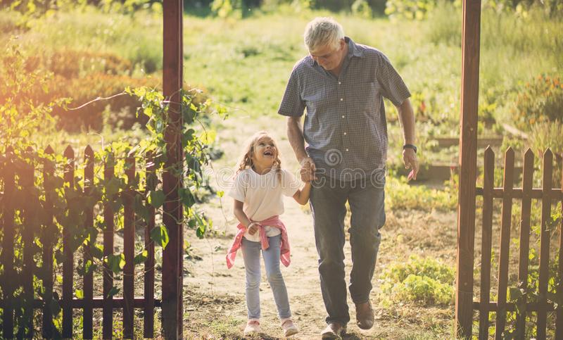 She enjoys talking to her grandfather. stock image