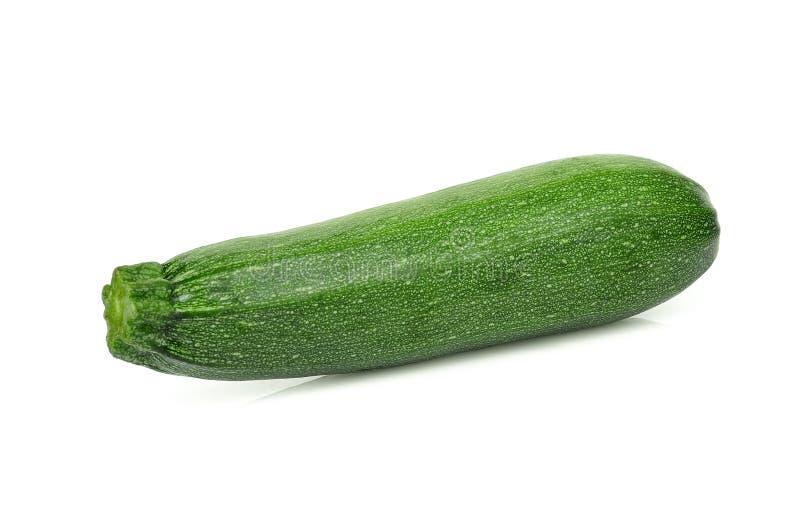 Enkel ny grön zucchini som isoleras på vit arkivfoto