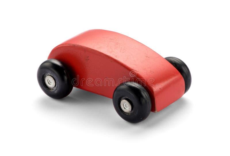 Enkel stiliserad röd träleksakbil arkivbilder