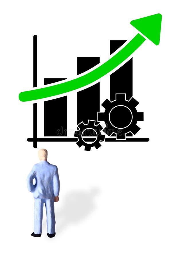 Enkelt begreppsmässigt foto, en stående affärsman som håller ögonen på grafiskt produktivitetsframsteg som lyfter upp stock illustrationer