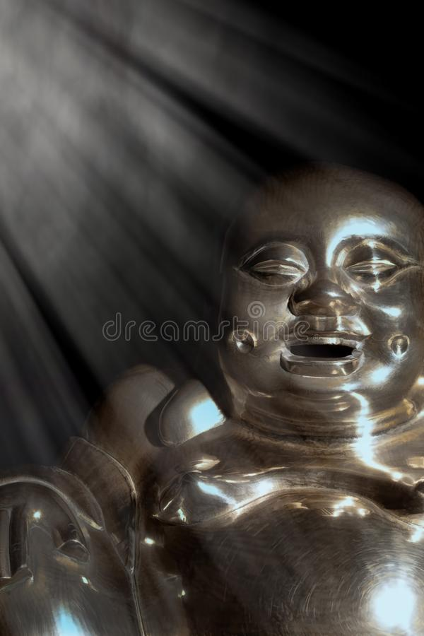 Enlightened Buddha. Brass statue of enlightened laughing monk. Enlightened Buddha. Brass statue of enlightened laughing monk under divine light. Slightly royalty free stock images