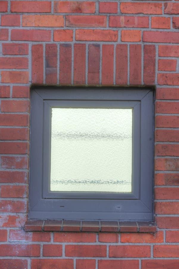 Enlightened Plastic Window. On abrick wall royalty free stock photo