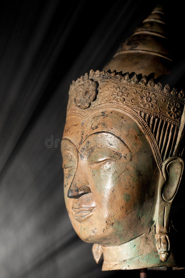 Enlightenment. Spiritual image of buddha head in a beam of light royalty free stock images