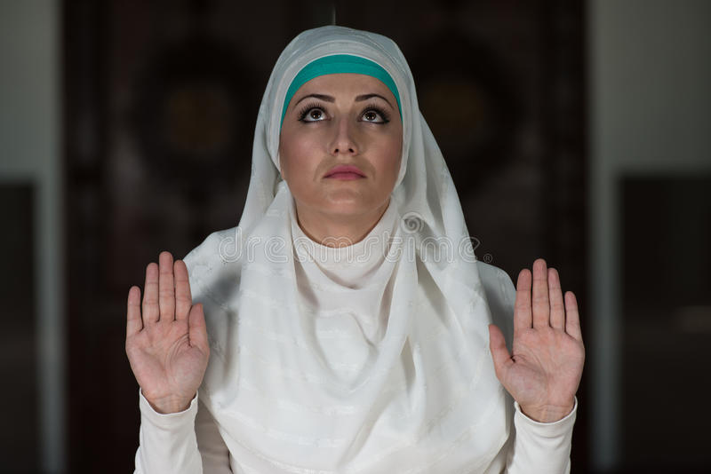 Enlightenment. Young Muslim Woman Praying In Mosque stock photos