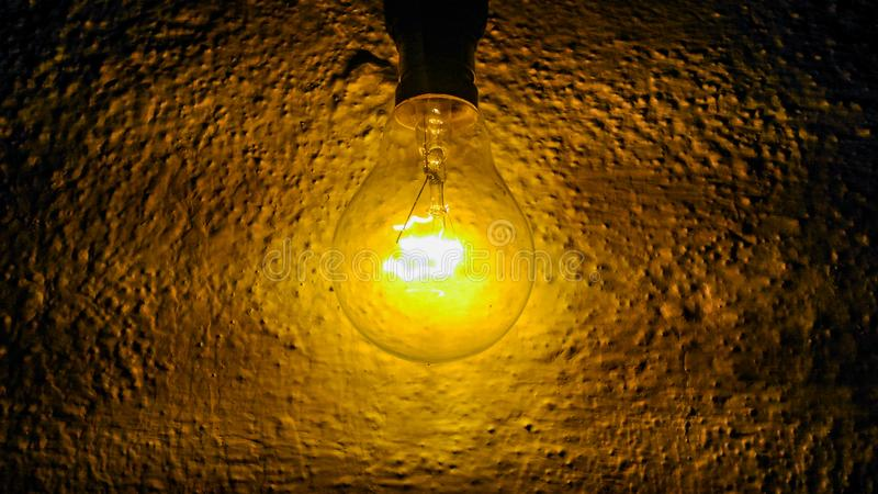 Enlightment. A closeup shot of glowing incandescent bulb royalty free stock image
