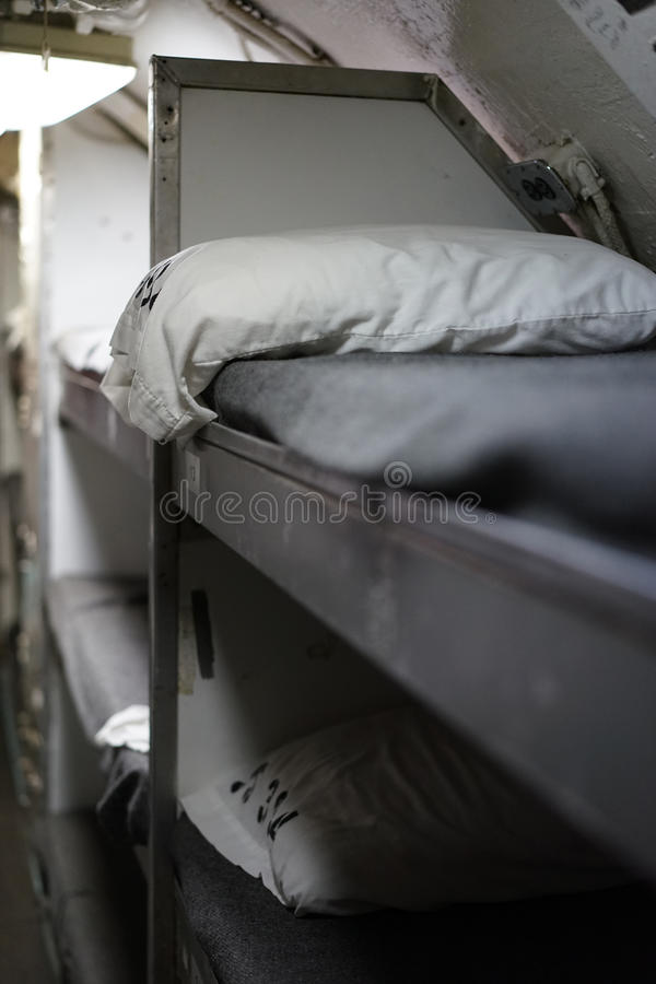 Enlisted men's bunkbeds aboard diesel submarine. The USS Razorback - 394, a World War II diesel submarine, had more personnel than beds, so enlisted men on stock photos