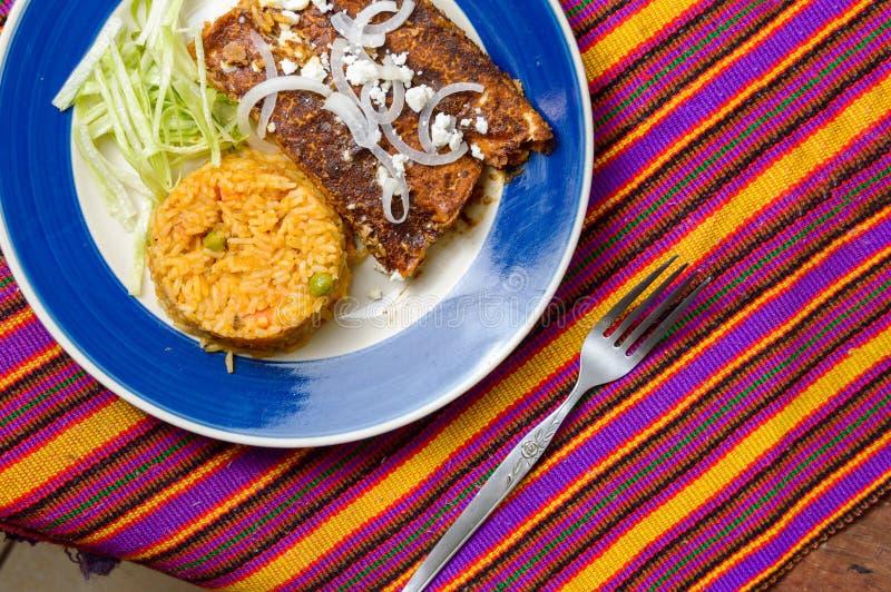 Enmoladas, Mexican enchiladas made with mole sauce royalty free stock images