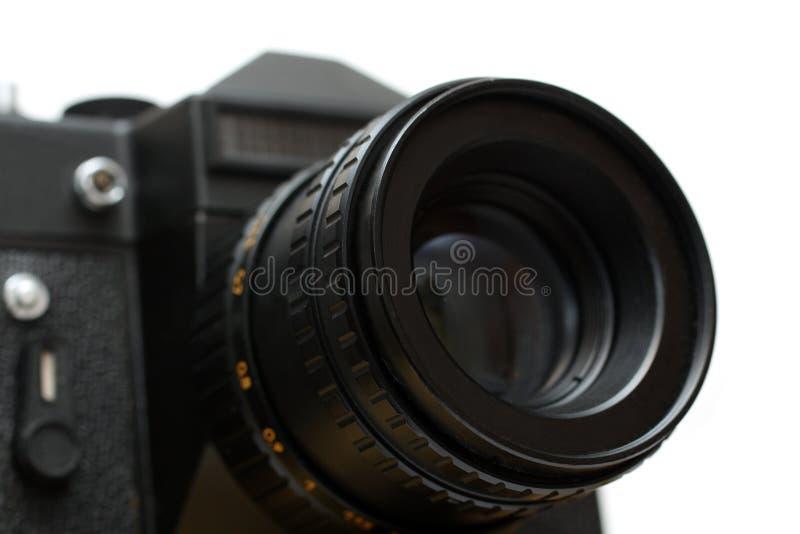 Ennegrezca la cámara del slr con el primer de la lente imágenes de archivo libres de regalías
