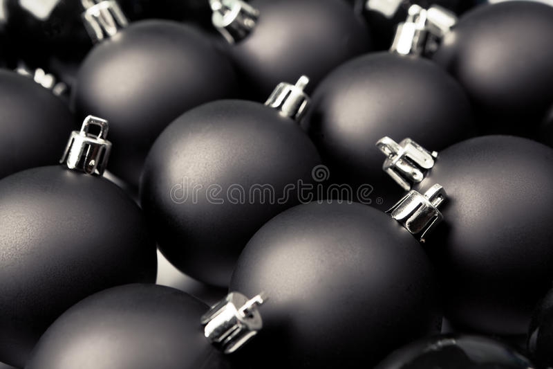 Ennegrezca las chucherías de la Navidad imagenes de archivo