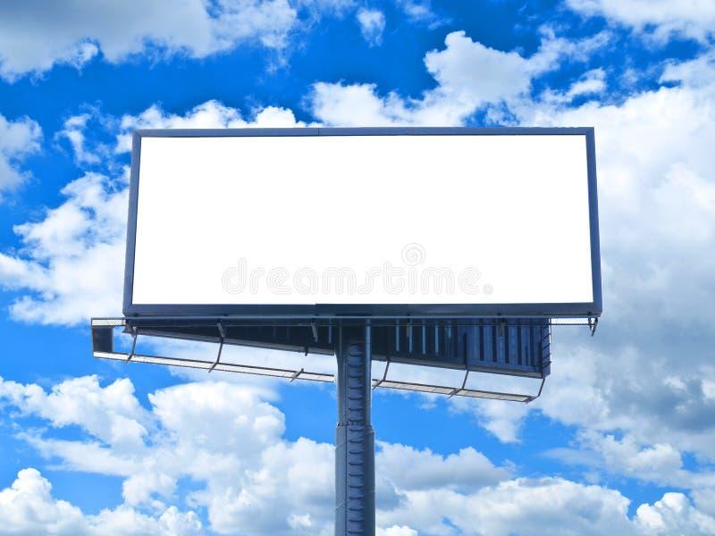 Enorm tom affischtavla mot blå himmel arkivfoto