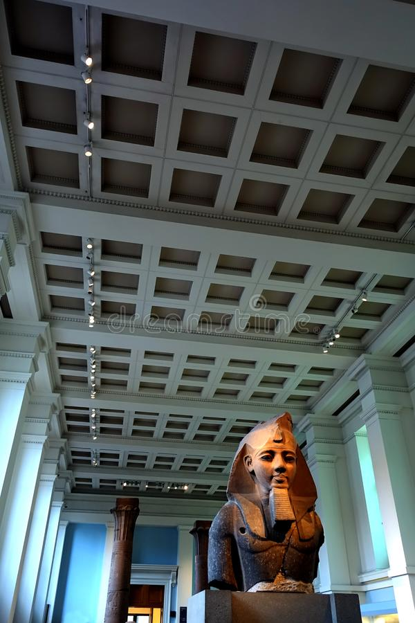 British Museum Ramesses II. The enormous granite bust of Ramesses the 2nd was found in the Pharaoh's mortuary temple located at Thebes in 1816. It is now royalty free stock photo