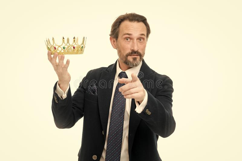 Enormous privilege. Become king ceremony. King attribute. Become next king. Monarchy family traditions. Man nature. Bearded guy in suit hold golden crown symbol royalty free stock images