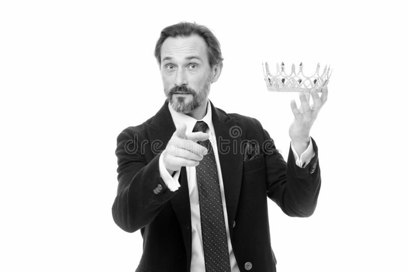 Enormous privilege. Become king ceremony. King attribute. Become next king. Monarchy family traditions. Man nature. Bearded guy in suit hold golden crown symbol stock photos
