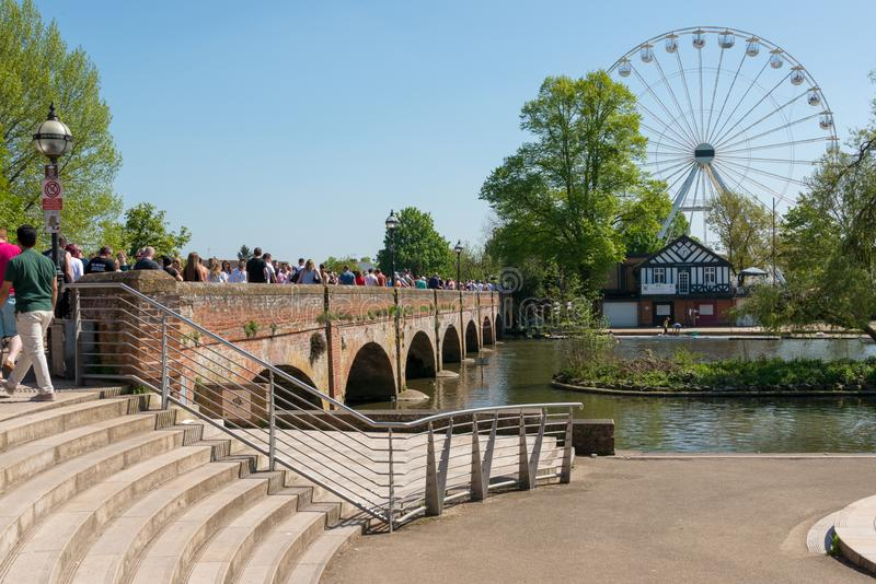 Enormous queue across footbridge for big wheel stock photos