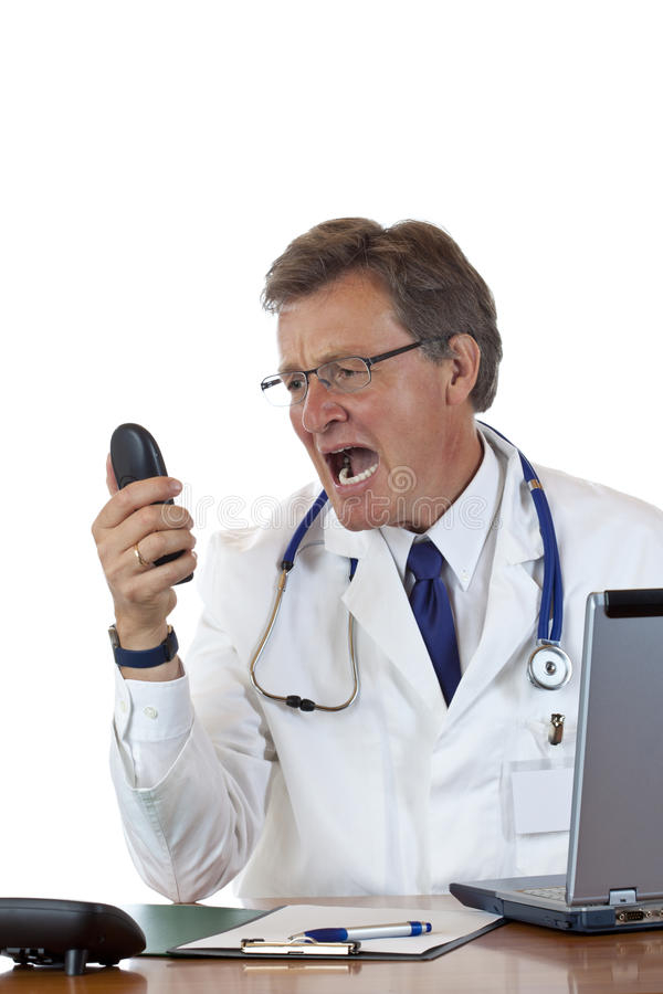 Enraged chief doctor screams loud into phone. Isolated on white background royalty free stock photo