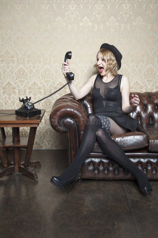 Enraged lady yelling on the phone. Stress stock photo