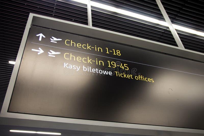 Enregistrement d'aéroport et signage de porte photos stock