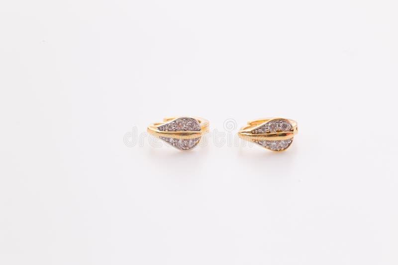 Enrelaçamentos Ouro Hoop Earrings com diamantes Joia fotos de stock