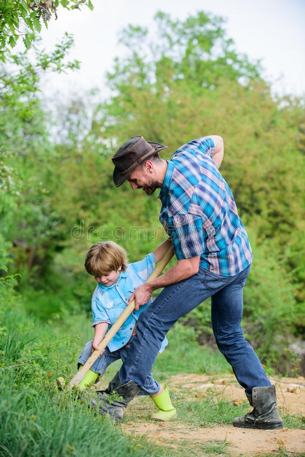 Enriching soil. happy earth day. Dig grounf with shovel. father and son planting family tree. new life. soils. Fertilizers. rich natural soil. Eco farm. Ranch stock images