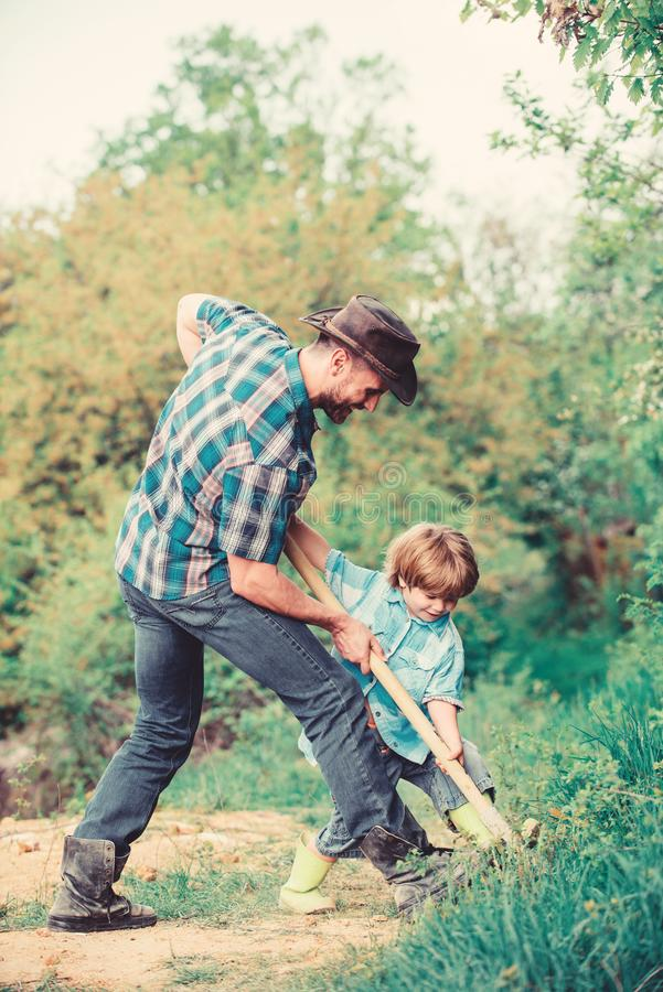 Enriching soil. happy earth day. Dig grounf with shovel. father and son planting family tree. new life. soils stock photo