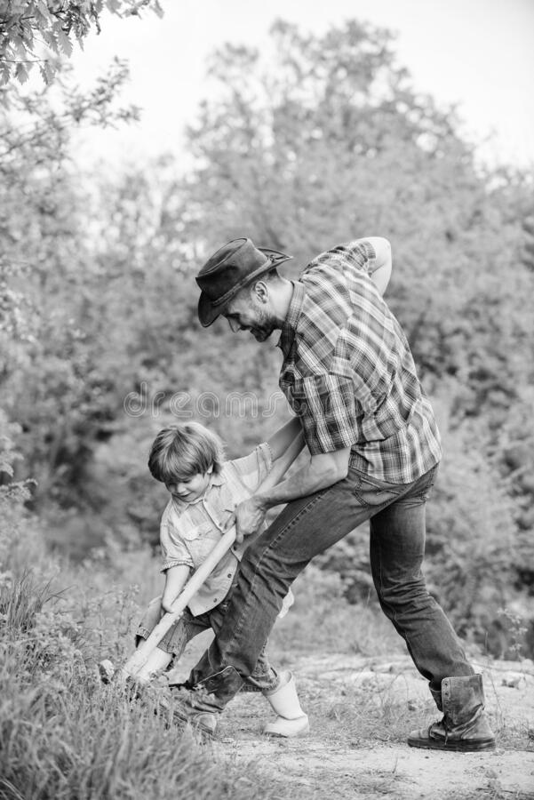 Enriching soil. happy earth day. Dig grounf with shovel. father and son planting family tree. new life. soils stock photos