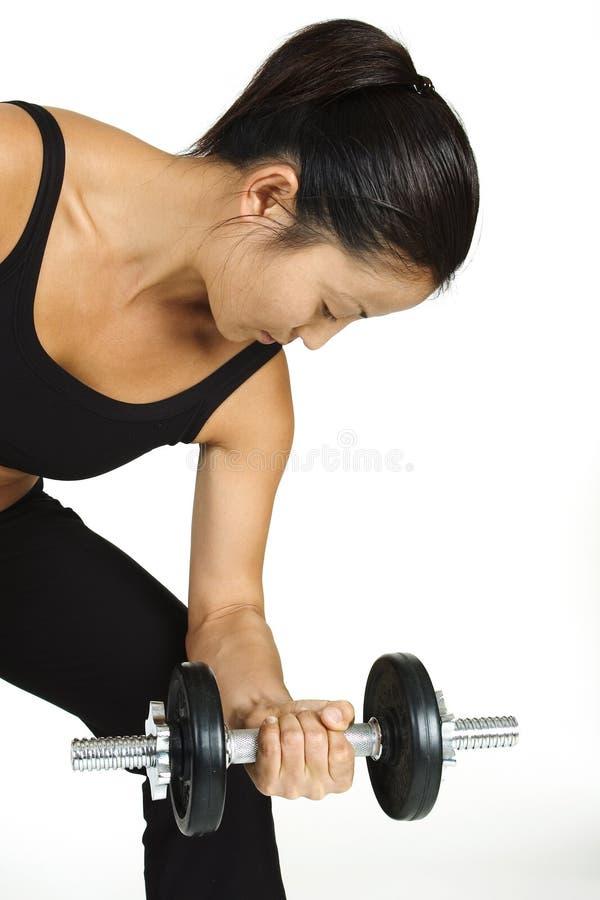 Enrollamiento 2 de la pesa de gimnasia imagen de archivo libre de regalías