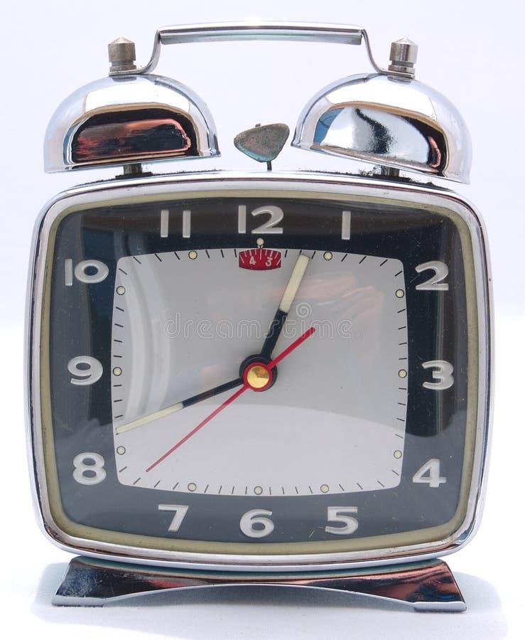 Enrolle para arriba el reloj de alarma mecánico fotografía de archivo