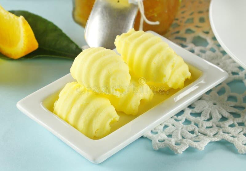 Enroulements de beurre photographie stock