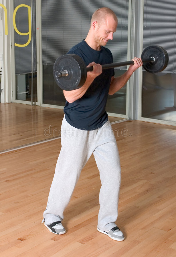 Enroulements de biceps image stock