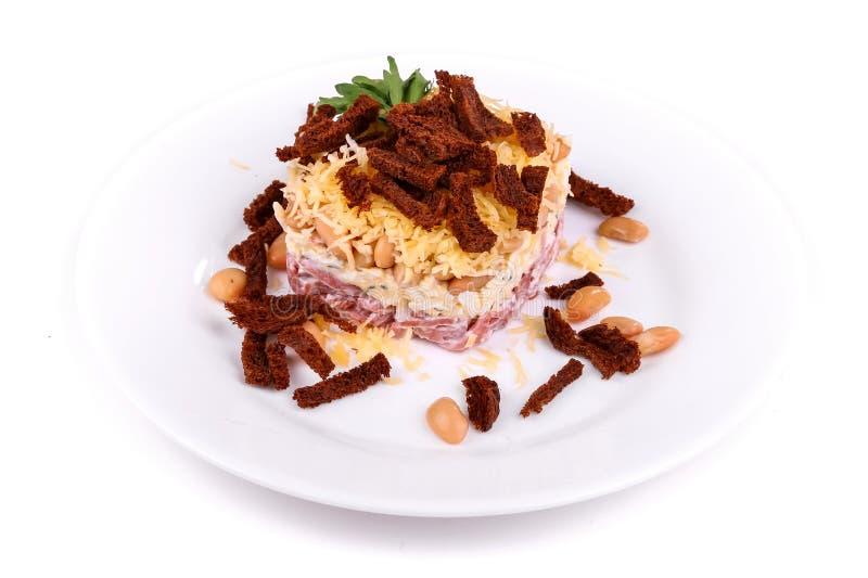 Ensalada del jamón, de habas, del queso y del bizcocho tostado foto de archivo