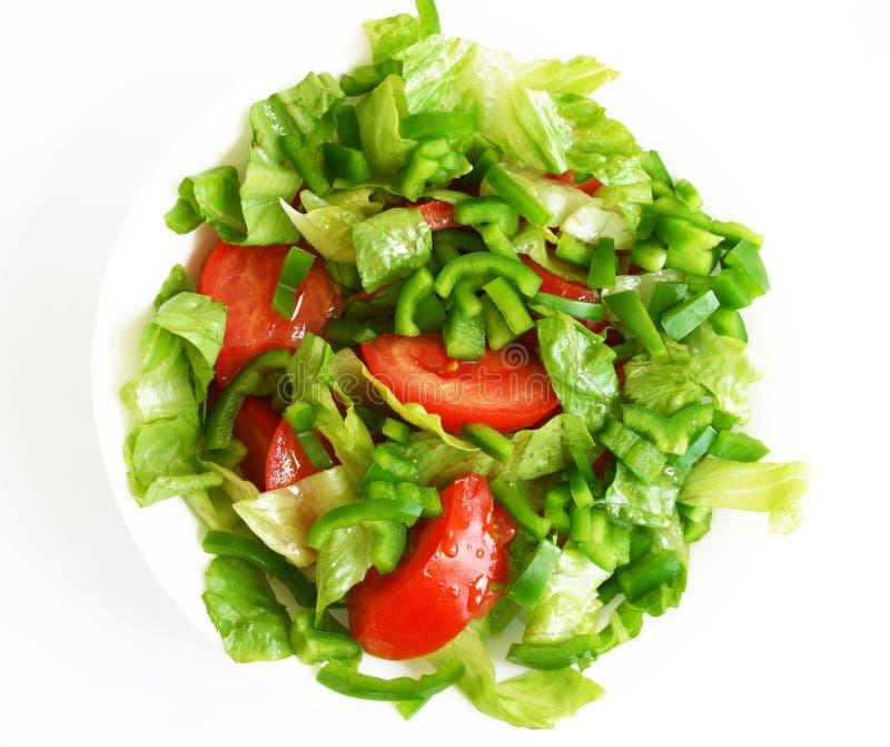 Ensalada vegetariana sana en la placa blanca imagen de archivo libre de regalías