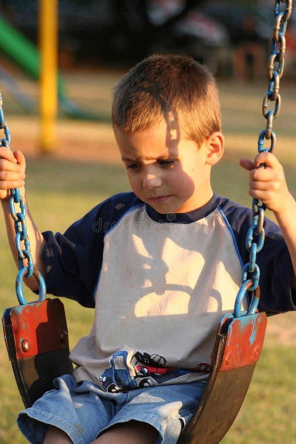 Download Ensamt barn arkivfoto. Bild av olyckligt, framsidor, ungar - 276476