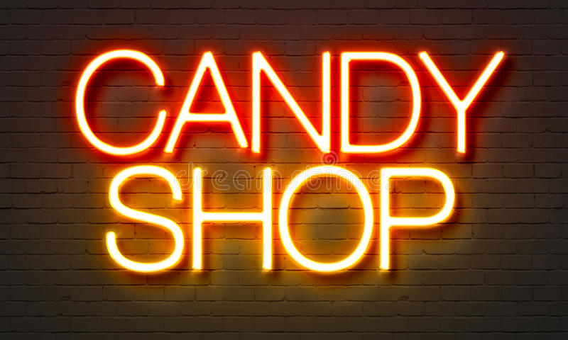 Enseigne au néon de boutique de sucrerie sur le fond de mur de briques images libres de droits