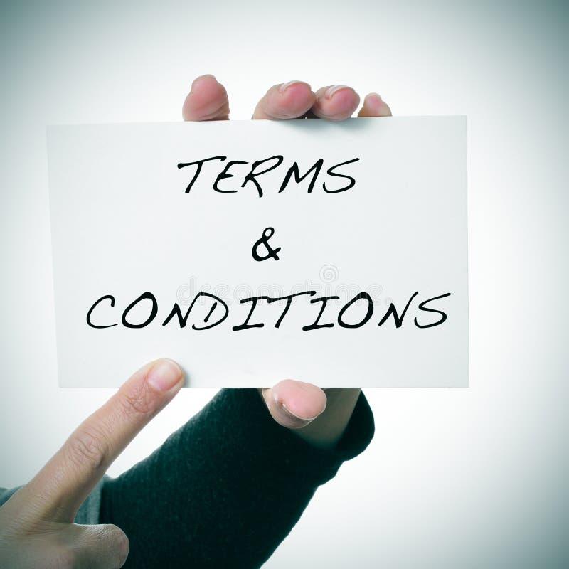 Enseigne avec les termes et conditions des textes images libres de droits