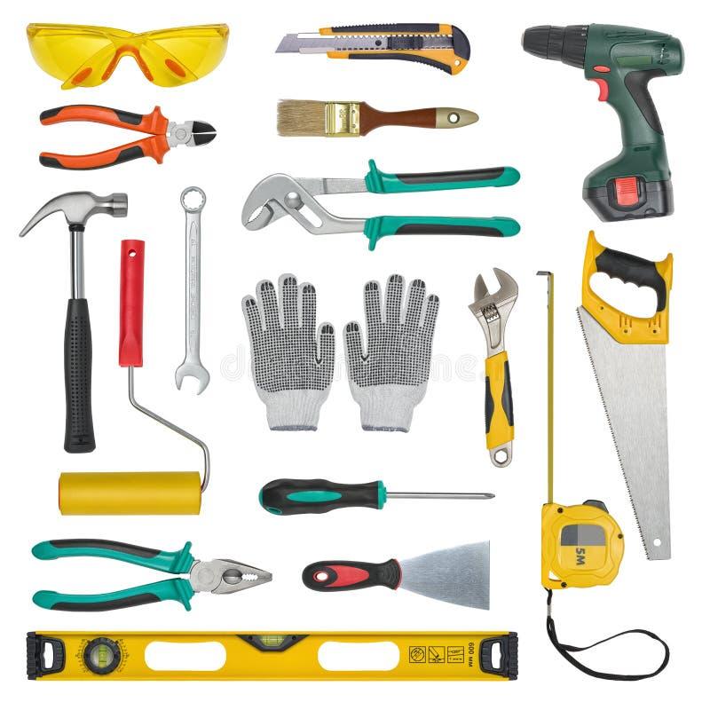 Ensemble d'outils de construction d'isolement sur un fond blanc Nivelez, scie, verres, ruban métrique, clé, clé, petit pain de pe photo stock