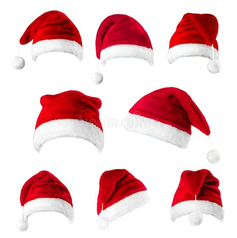 Ensemble de chapeaux rouges du Père Noël isolés sur fond blanc photographie stock libre de droits