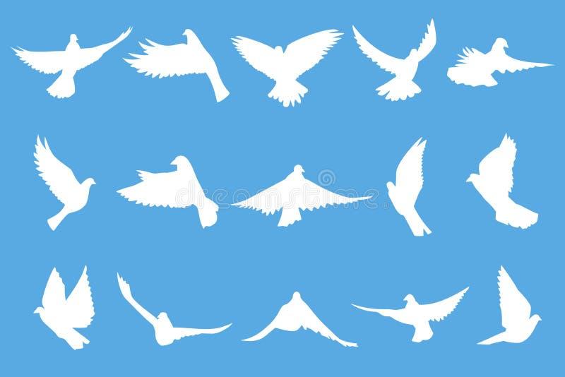Ensemble de colombes de vol sur le fond bleu illustration libre de droits