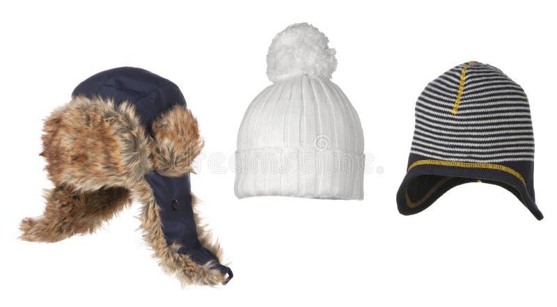 Ensemble de différents chapeaux de l'hiver d'isolement sur le blanc photos stock