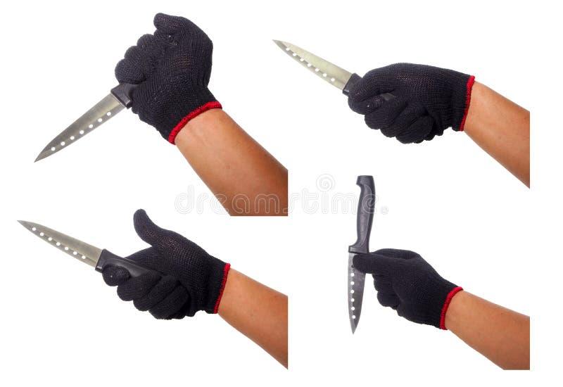 Ensemble de main tenant le couteau avec le gant noir photographie stock libre de droits