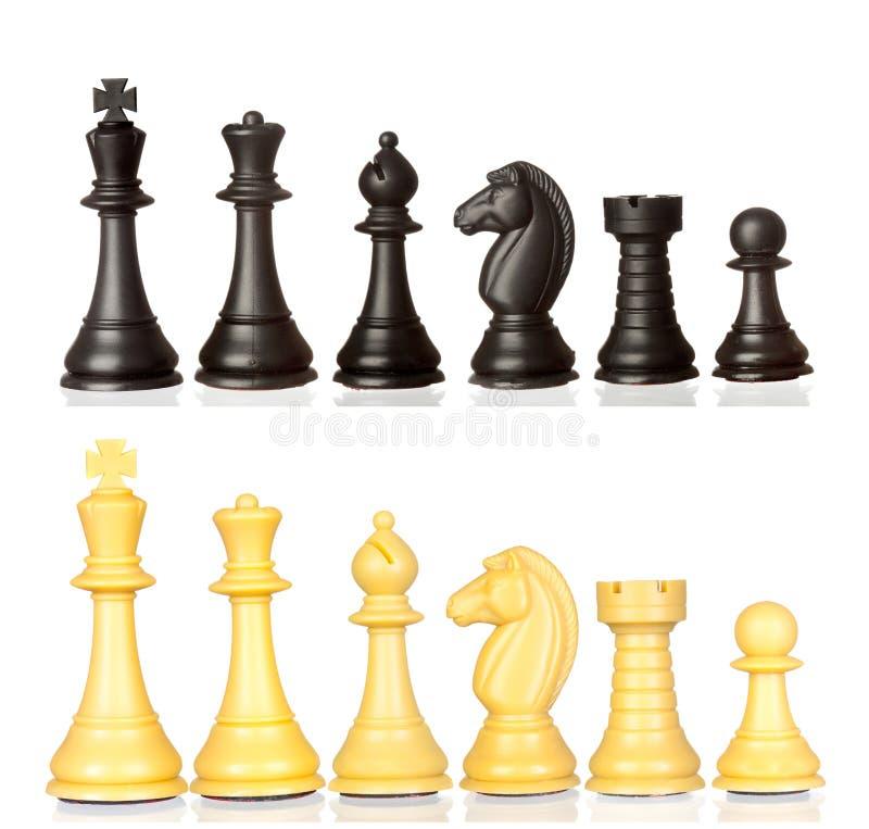 Ensemble de pièces d'échecs noires et blanches photographie stock libre de droits