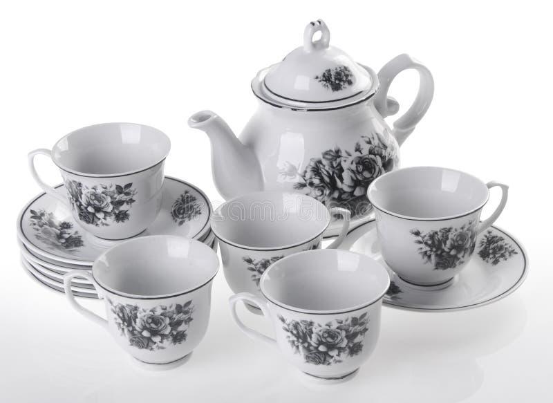 Ensemble de pot de thé, pot de thé de porcelaine et tasse sur le fond blanc photo stock