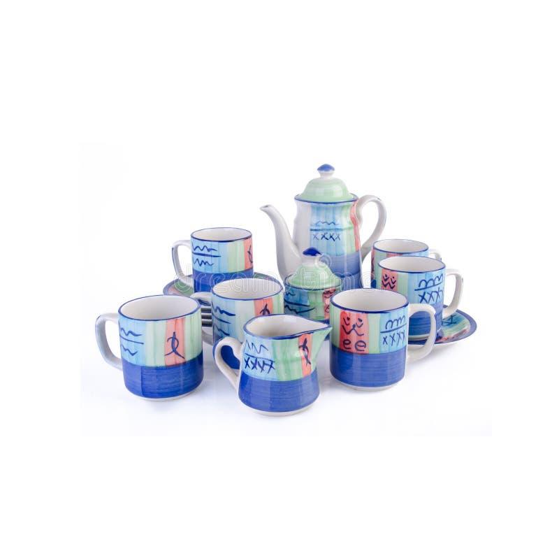 Ensemble de pot de thé, pot de thé de porcelaine et tasse sur le fond image libre de droits