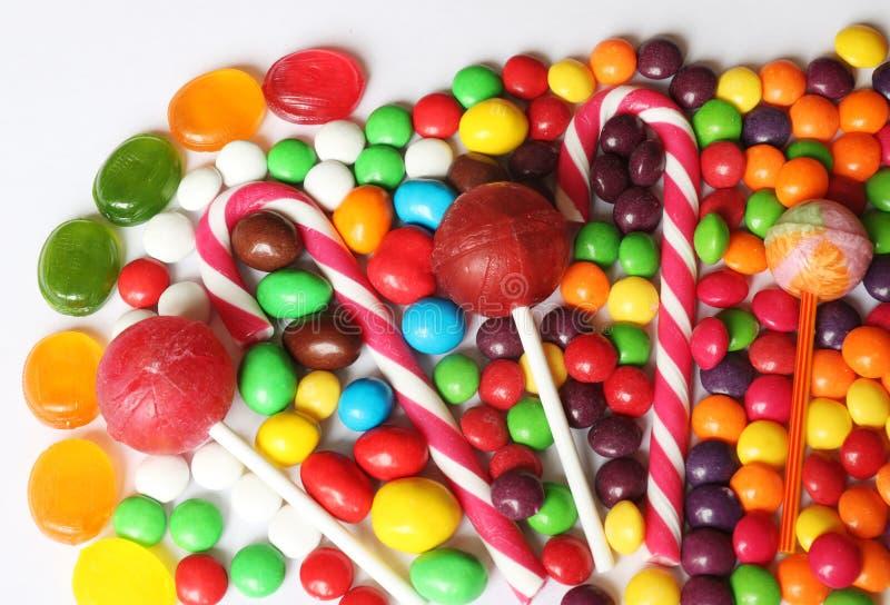 Ensemble de sucreries assorties lumineuses images stock