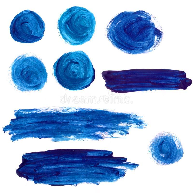 Ensemble de taches bleues et de courses de peinture acrylique photos libres de droits