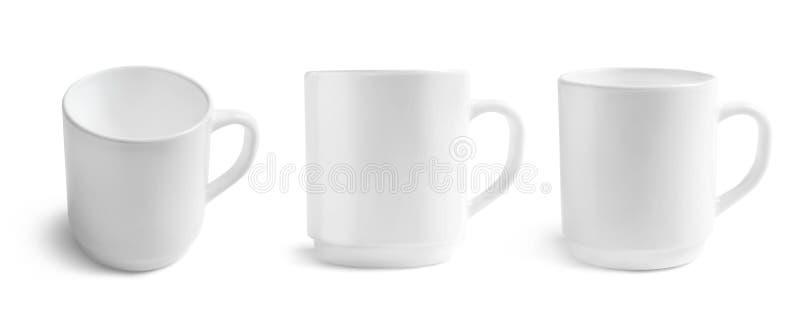 Ensemble de tasses vides sur le fond blanc Maquette pour la conception image stock