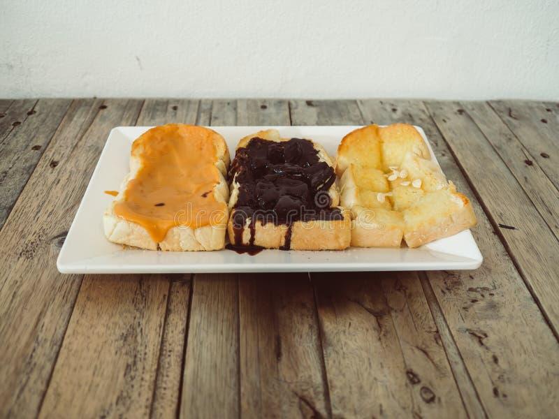 Ensemble de trois bonbons de pains grillés images stock