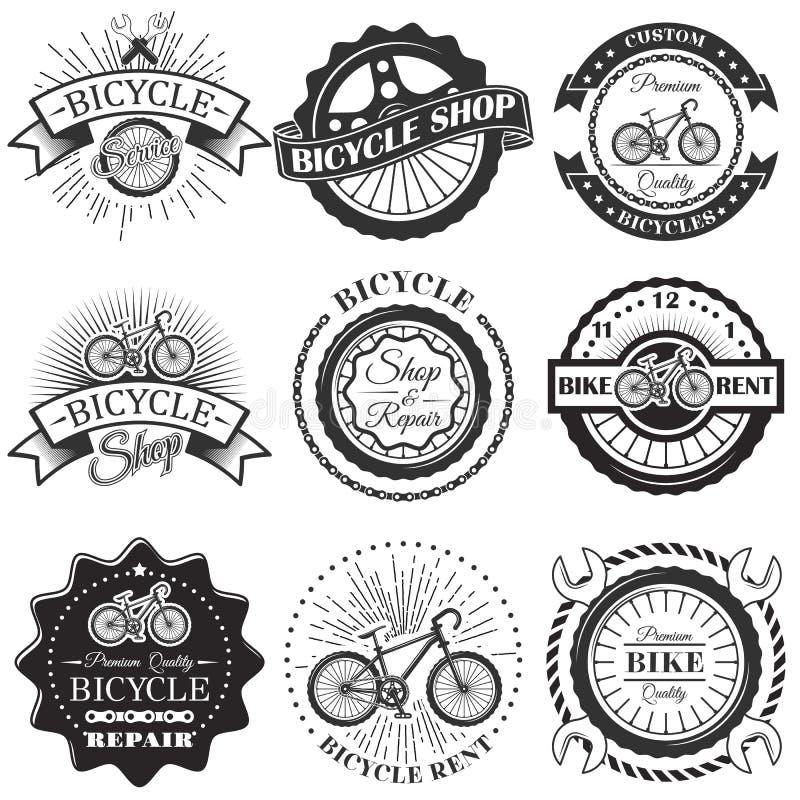 Ensemble de vecteur de labels d'atelier de réparations de bicyclette et d'éléments de conception dans le style noir et blanc de v illustration libre de droits